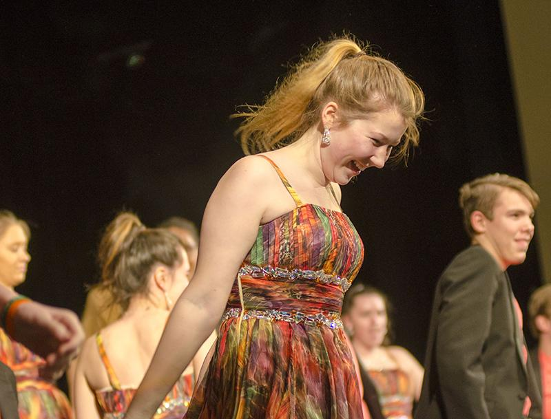 "Junior Hope  Keithahn looks down with a smile as she prepares to whip her head up, letting her hair stand out in the front row. ""It's always useful to perform in front of an audience,""  junior show choir member Greta McNamee said. ""Especially gearing up to the beginning of competition season."""