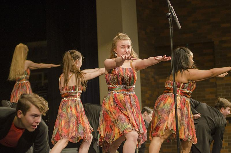 Junior Allison Whittom extends her arms out as the final pose of City Lights' performance. The show is upbeat and exciting to any audience. The show choir will kick off its competition season next Saturday, Jan. 19 in Pleasant Hill.