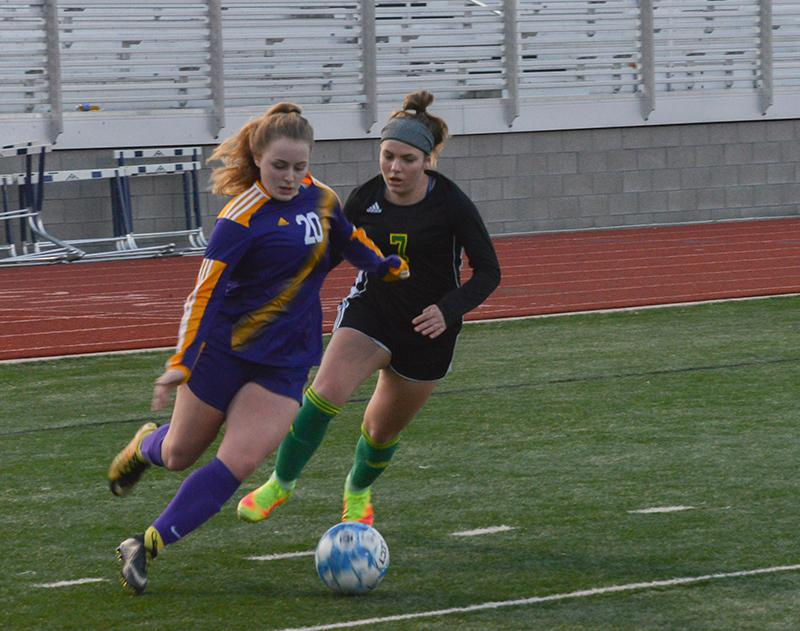 Sophomore midfielder Hannah Juengermann takes on an HHS forward. The 2019 season is Juengermann's second year as a varsity Bruin. Juengermann helps the team from the center of the field.