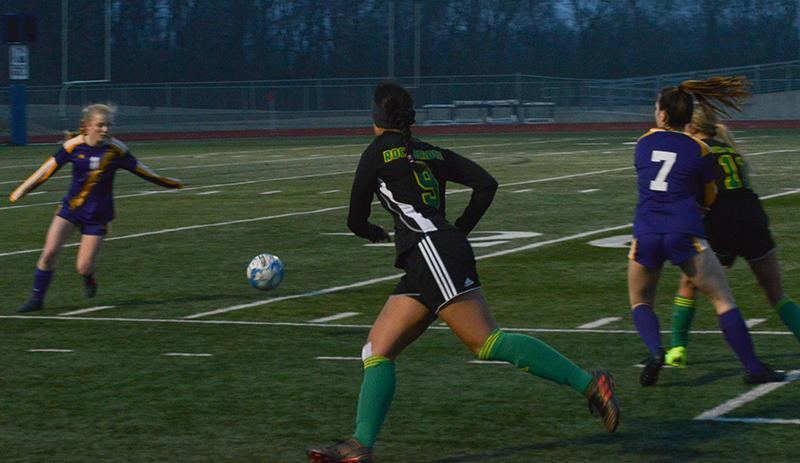 Sophomore forward Istahil Omar takes on a ball heading towards the goal. Omar is one of the underclassmen who are adjusting to the team's new leadership dynamic after losing seven seniors.