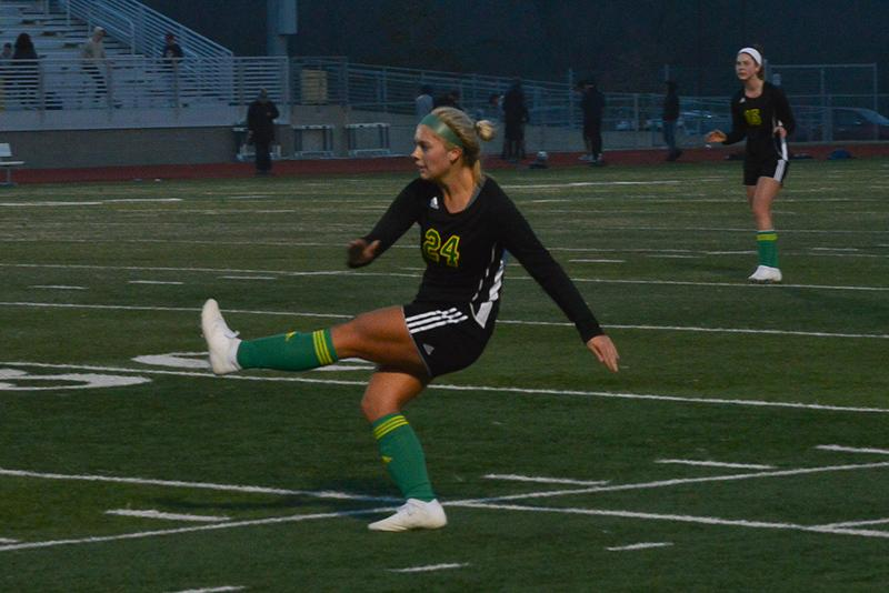 Junior midfielder Caroline Cole follows through a solid free kick. Cole has been a varsity starter since her freshman year and showcased her domination in the midfield at the jamboree.