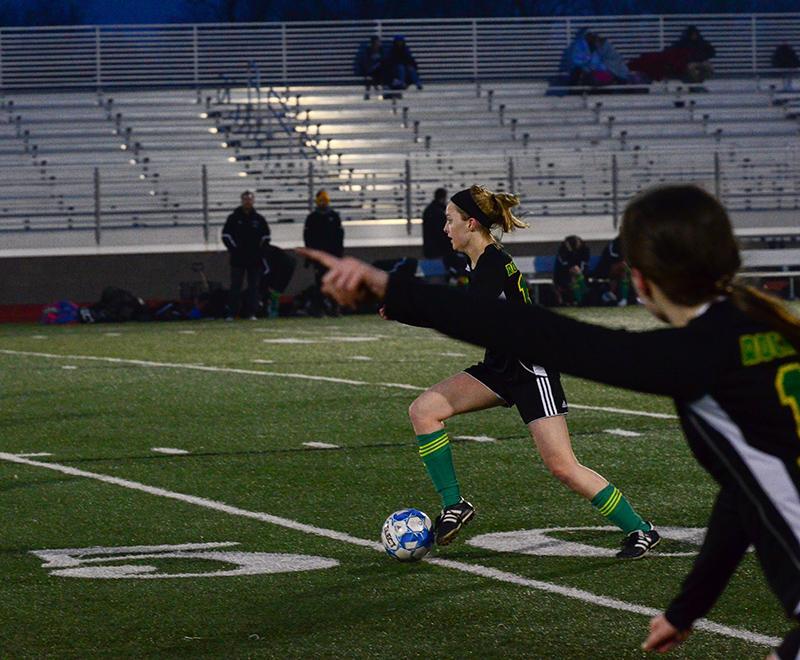 Senior midfielder Zoey Princivalli leads junior midfielder Grace Cunningham to the corner. Several seniors, including Princivalli, will step into leadership positions this season as the team.