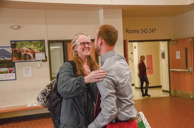 When he entered the school, he hugs former teacher Lisa Boyer. Photo by Allie Pigg