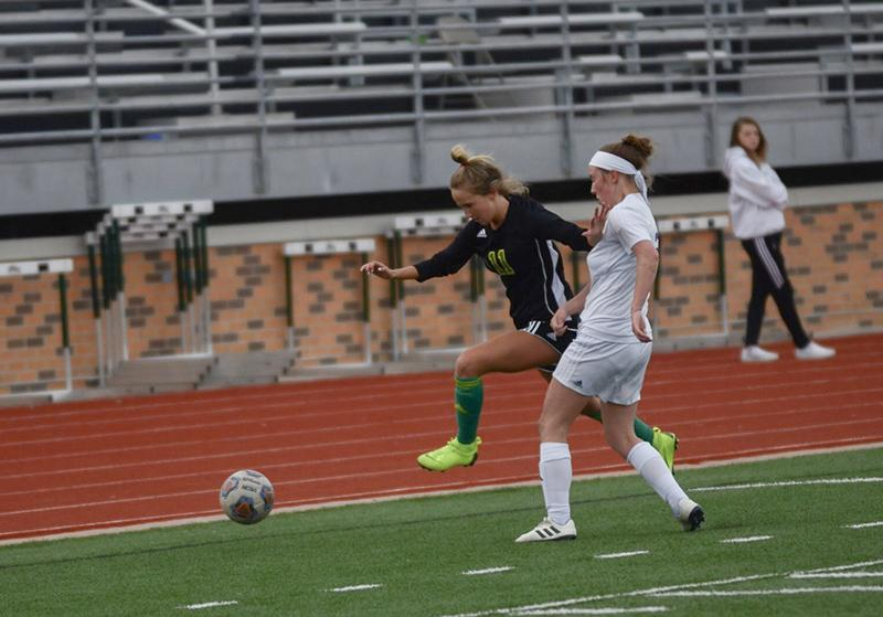 Senior Hannah Greenplate plows through a defender during the first half against PHHS. Despite strong offensive efforts, the Bruins could not find the back of the net.