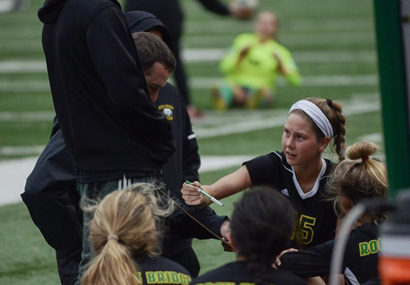 """Senior captain and defender Alexis Kliethermes looks to her coach as she joins him in the halftime talk. """"Tonight I thought our biggest strength was effort,"""" Kliethermes said. """"Even though it was a frustrating game, we continued to give 100% effort for the entire 80 minutes."""""""