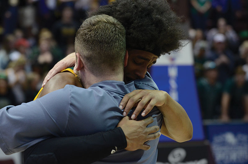 Senior Ja'Monta Black cries after the Bruins win the state championship Saturday, March 16, as he hugs Coach Blaire Scanlon, the head coach's son. This was the first time the Rock Bridge boys' basketball team took home the title. Photo by Camryn DeVore
