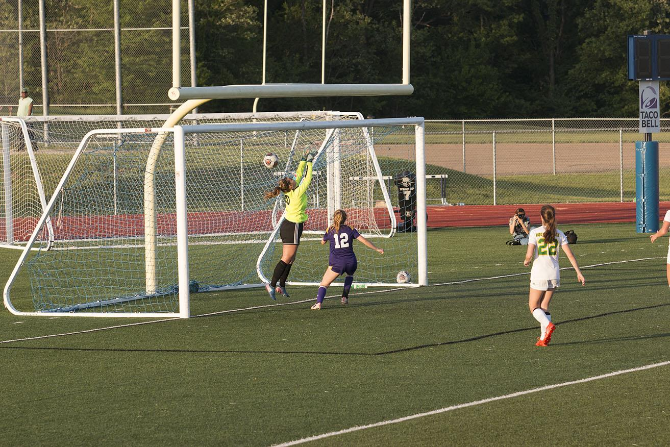 Morgan Boussad (11) trying the best she can trying to defend the goal when the ball went into the net. Ending to a 1-0 score with Hickman in the lead against Rock Bridge. Photo by Payton Bealmear